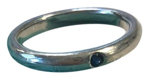 Tiffany & Co. Tiffany & Co. Elsa Peretti sterling silver stacking ring with sapphire.