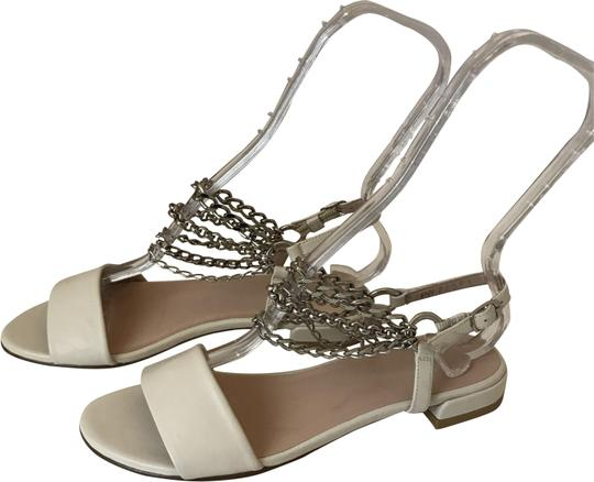 Preload https://img-static.tradesy.com/item/24148139/stuart-weitzman-white-8918-wsilver-chain-on-the-front-6m-sandals-size-us-6-regular-m-b-0-2-540-540.jpg