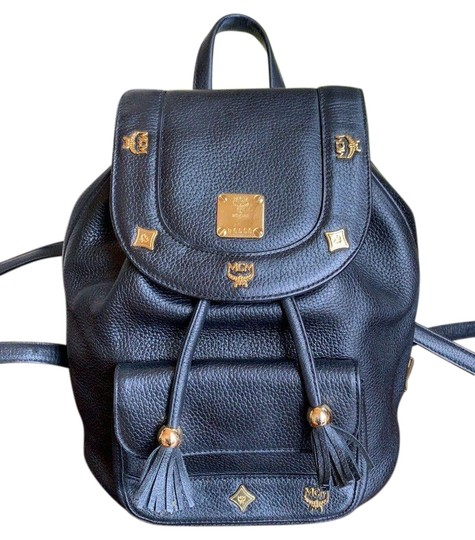 Preload https://img-static.tradesy.com/item/24148167/mcm-w-golden-studded-logo-motifs-and-drawstrings-mini-black-leather-backpack-0-1-540-540.jpg