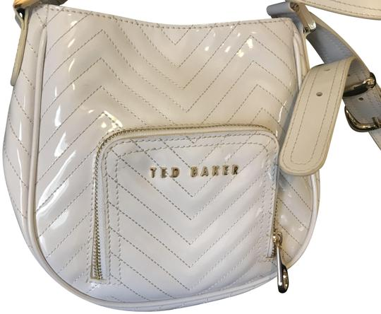 Preload https://img-static.tradesy.com/item/24148173/ted-baker-with-front-pocket-white-patent-leather-cross-body-bag-0-1-540-540.jpg