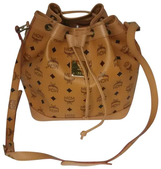 Preload https://img-static.tradesy.com/item/24156585/mcm-monogram-drawstring-bucket-tan-coated-canvas-shoulder-bag-0-3-540-540.jpg