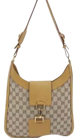 Preload https://img-static.tradesy.com/item/24157827/leather-yellow-and-brown-canvas-shoulder-bag-0-1-540-540.jpg