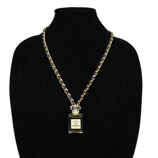 Preload https://img-static.tradesy.com/item/24165481/chanel-gold-black-5-perfume-bottle-pendant-with-and-chain-necklace-0-0-540-540.jpg