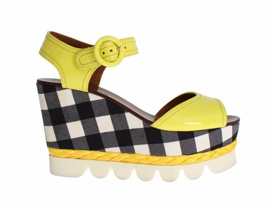 Preload https://img-static.tradesy.com/item/24165509/dolce-and-gabbana-dolce-and-gabbana-yellow-leather-check-wedges-platform-pumps-size-us-95-regular-m-0-0-540-540.jpg