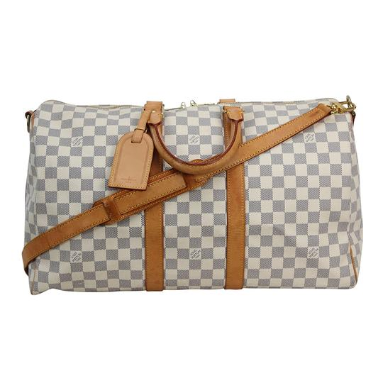 Preload https://img-static.tradesy.com/item/24165617/louis-vuitton-keepall-bandouliere-45-damier-azur-white-canvas-weekendtravel-bag-0-0-540-540.jpg