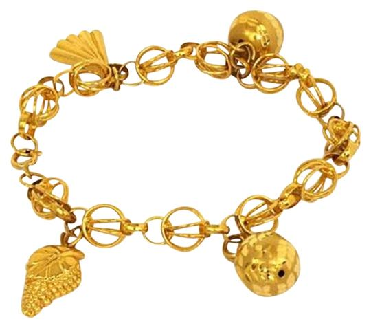 Preload https://img-static.tradesy.com/item/24165822/11540-21k-gold-dangling-charms-bracelet-0-1-540-540.jpg
