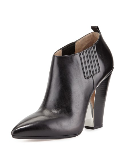 Preload https://img-static.tradesy.com/item/24165865/michael-kors-collection-black-lacy-pointed-toe-bootsbooties-size-eu-375-approx-us-75-regular-m-b-0-0-540-540.jpg