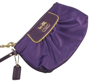 Coach Wristlet in Purple with Gold details