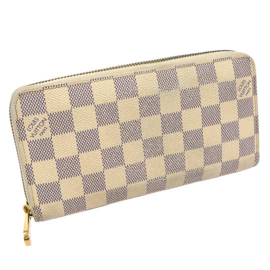 Preload https://img-static.tradesy.com/item/24166121/louis-vuitton-damier-azur-zippy-wallet-0-0-540-540.jpg