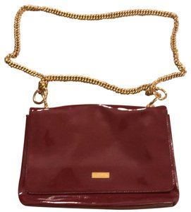 Halston Satchel in burgundy and gold chain