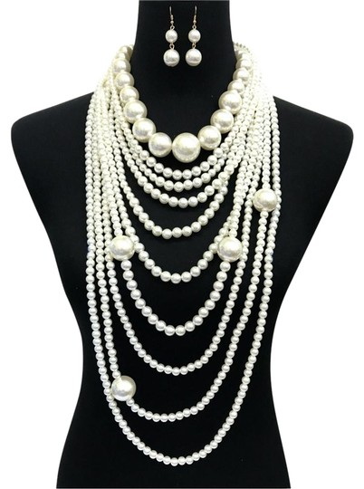 Preload https://img-static.tradesy.com/item/24176180/cream-gold-long-multi-layered-pearl-and-earrings-necklace-0-1-540-540.jpg