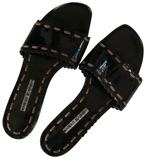 Preload https://img-static.tradesy.com/item/24176211/manolo-blahnik-black-flats-sandals-size-eu-39-approx-us-9-regular-m-b-0-1-540-540.jpg
