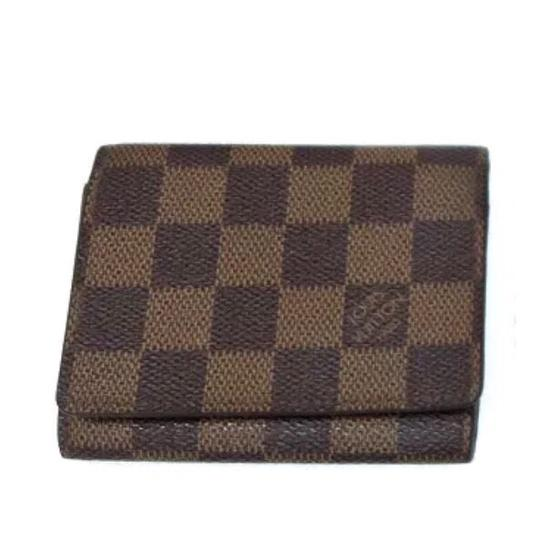 Preload https://img-static.tradesy.com/item/24177674/louis-vuitton-brown-monogram-damier-ebene-checker-card-wallet-0-0-540-540.jpg