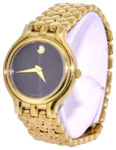 Movado Authantic Movado 87.E3.817 yellow, silver tone, stainless steel, water resistant, black face lady's watch. New battery