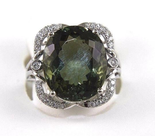 Preload https://img-static.tradesy.com/item/24181367/green-and-silver-oval-cut-tourmaline-gemstone-wdiamond-halo-14k-wg-992ct-ring-0-1-540-540.jpg