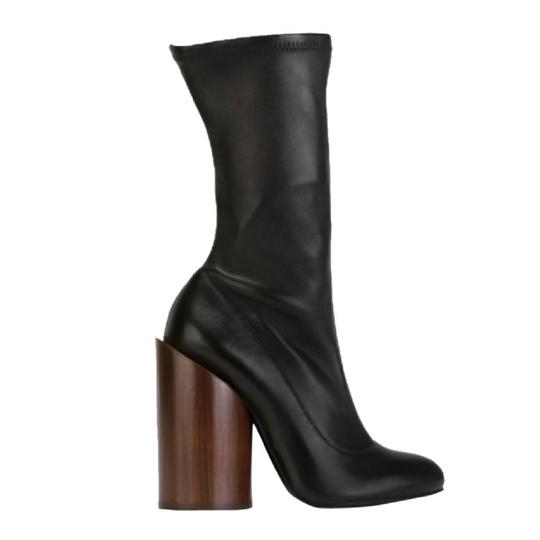 Preload https://img-static.tradesy.com/item/24181691/givenchy-black-12010285-bootsbooties-size-eu-38-approx-us-8-regular-m-b-0-0-540-540.jpg