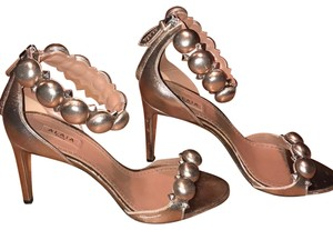 ALAÏA Rose Gold Pumps