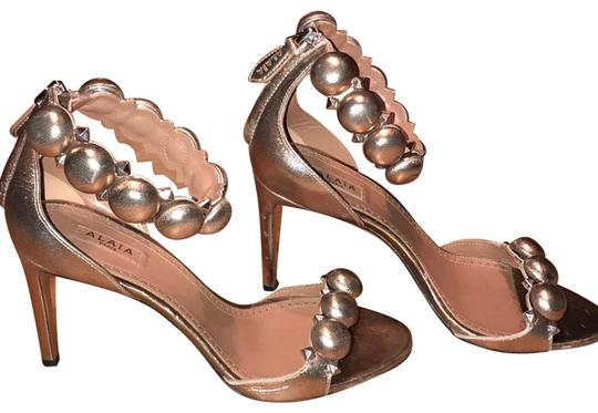 Preload https://img-static.tradesy.com/item/24181821/alaia-rose-gold-studded-heels-pumps-size-eu-37-approx-us-7-regular-m-b-0-2-540-540.jpg