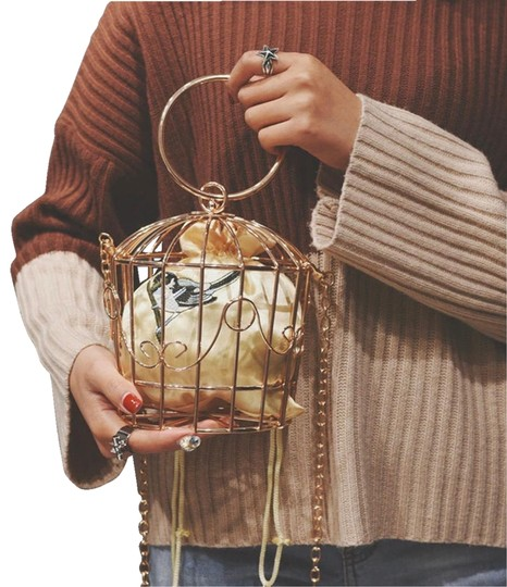 Caged Bird Wristlet in Gold Image 0