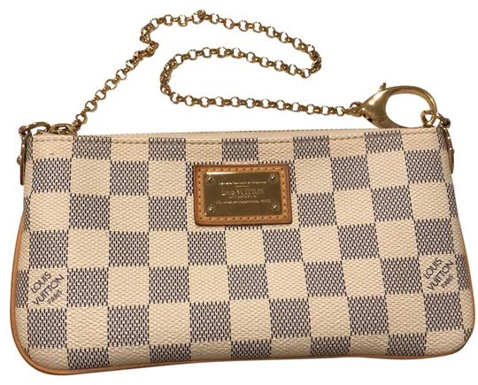 Preload https://img-static.tradesy.com/item/24186097/louis-vuitton-pochette-damier-azul-canvas-mila-mm-white-leather-clutch-0-1-540-540.jpg