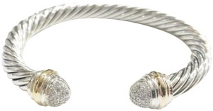 David Yurman David Yurman Pavé Diamond Two Tone Classic Cable Bracelet Sterling silver and 18k yellow gold Beautiful pavé style diamonds at both ends of bangle with 18k yellow gold bands Medium, 7mm 100% Authentic Guaranteed Comes inside original David Yurman pouch!