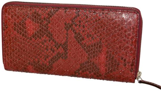 Preload https://img-static.tradesy.com/item/24187513/gucci-red-python-micro-gg-leather-made-in-italy-wallet-0-1-540-540.jpg