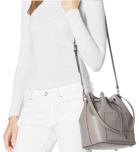 Newwwww. With classic hardware and both shoulder and crossbody straps, the Greenwich bucket bag takes a modern staple to a new level of luxe. You'll want to make this leather style your everyday partner. Saffiano Leather Gleaming Hardware Top Handle: 11