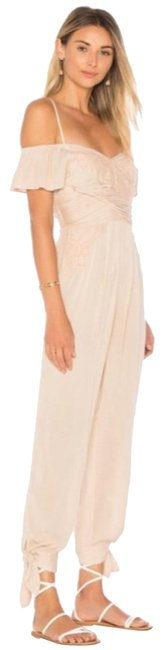 Preload https://img-static.tradesy.com/item/24191870/free-people-ivory-blush-in-the-moment-romperjumpsuit-0-1-650-650.jpg