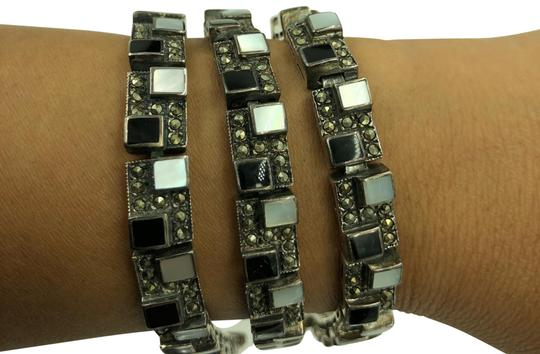 Preload https://img-static.tradesy.com/item/24193289/black-white-and-silver-925-ster-onyx-mother-of-pearl-and-marcasite-pattern-design-bracelet-0-1-540-540.jpg