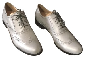 Cole Haan reflective silver/grey Flats