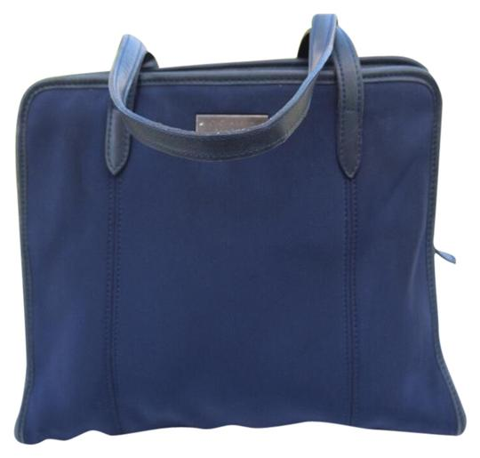 Preload https://img-static.tradesy.com/item/24198846/coach-vintage-navy-blue-stretchy-fabric-and-leather-tote-0-1-540-540.jpg