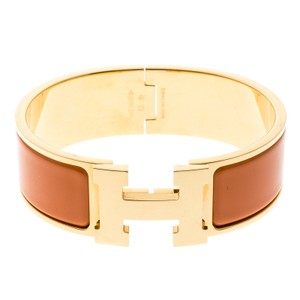 Hermès Clic Clac H Gold Plated Orange Enamel Bracelet