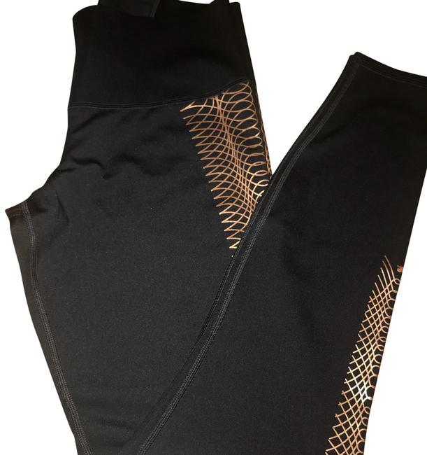 Preload https://img-static.tradesy.com/item/24199375/puma-black-and-gold-full-length-with-copper-design-activewear-bottoms-size-12-l-0-1-650-650.jpg