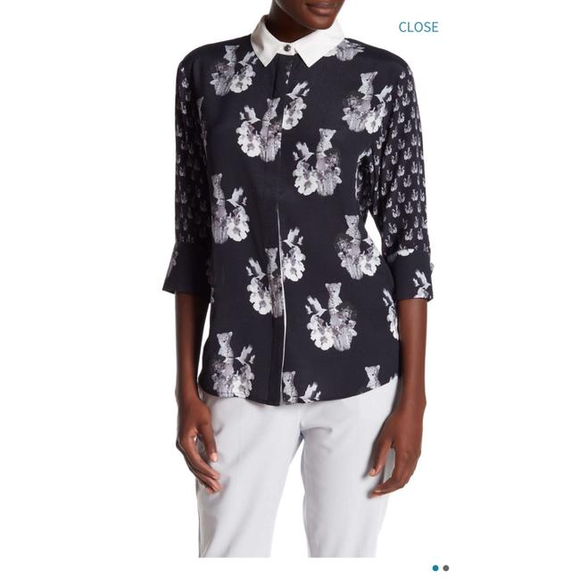 Preload https://img-static.tradesy.com/item/24209925/navy-ivory-cheetah-print-blouse-button-down-top-size-6-s-0-0-650-650.jpg