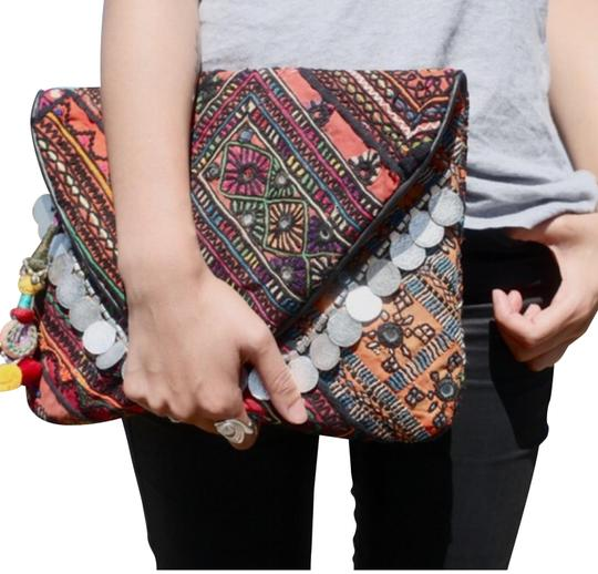 Preload https://img-static.tradesy.com/item/24210546/antik-batik-banjo-embellished-clutch-0-1-540-540.jpg