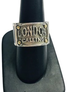 "Stephen Webster NEVER WORN!! Stephen Webster ""London Calling"" Silver Yellow Gold Plated and Onyx Band Ring Sterling Silver Yellow Gold Plated Onyx 10.1 grams Size: 9.5 100% Authentic Guaranteed!! Comes with Original Stephen Webster Pouch!!"