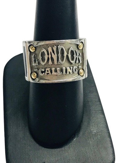 Preload https://img-static.tradesy.com/item/24213772/stephen-webster-never-worn-london-calling-silver-yellow-gold-plated-and-onyx-band-sterling-silver-ye-0-1-540-540.jpg