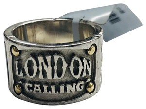 """Stephen Webster NEVER WORN!! Stephen Webster """"London Calling"""" Silver Yellow Gold Plated and Onyx Band Ring Sterling Silver Yellow Gold Plated Onyx 10.1 grams Size: 8.75 100% Authentic Guaranteed!! Comes with Original Stephen Webster Pouch!!"""