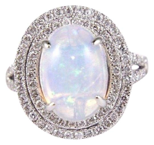 Preload https://img-static.tradesy.com/item/24213838/white-and-silver-oval-opal-solitaire-wdiamond-halo-accents-14k-wg-415ct-ring-0-1-540-540.jpg