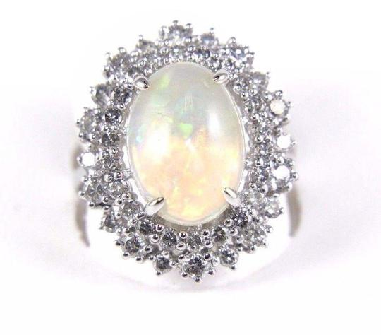 Preload https://img-static.tradesy.com/item/24213902/white-and-silver-oval-cut-opal-solitaire-wdiamond-halo-14k-wg-424ct-ring-0-1-540-540.jpg