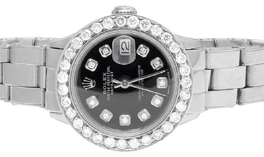 Preload https://img-static.tradesy.com/item/24214337/rolex-stainless-steel-ladies-26mm-datejust-oyster-black-dial-diamond-25-ct-watch-0-1-540-540.jpg