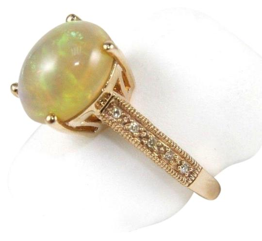 Preload https://img-static.tradesy.com/item/24214868/multi-color-oval-fire-opal-gemstone-and-diamond-lady-s-solitaire-14k-rg-2600ct-ring-0-1-540-540.jpg