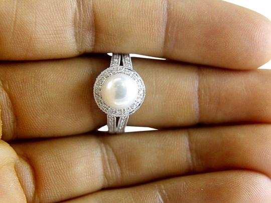 Preload https://img-static.tradesy.com/item/24215303/white-and-silver-freshwater-pearl-diamond-halo-solitaire-14k-wg-9mm-32ct-ring-0-6-540-540.jpg