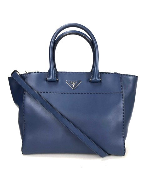Preload https://img-static.tradesy.com/item/24217107/prada-galleria-double-hand-stitched-zip-blue-leather-tote-0-1-540-540.jpg