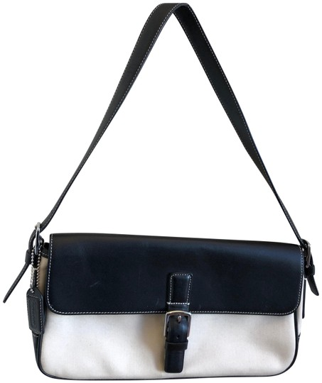 Preload https://img-static.tradesy.com/item/24217453/coach-black-and-tan-leather-canvas-clutch-0-1-540-540.jpg