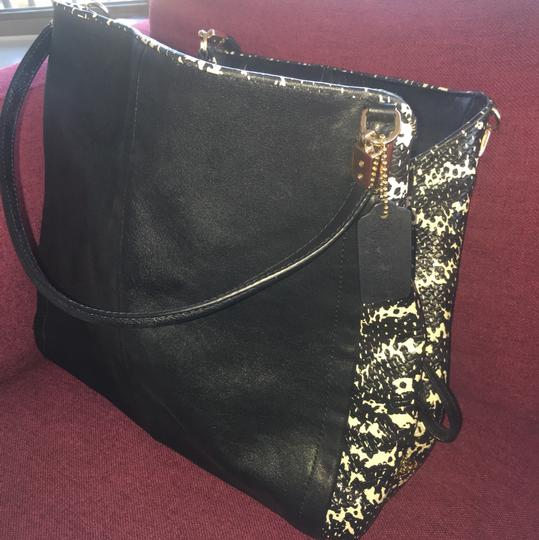 Coach Bag Satchel in Black outer and black and white in the middle