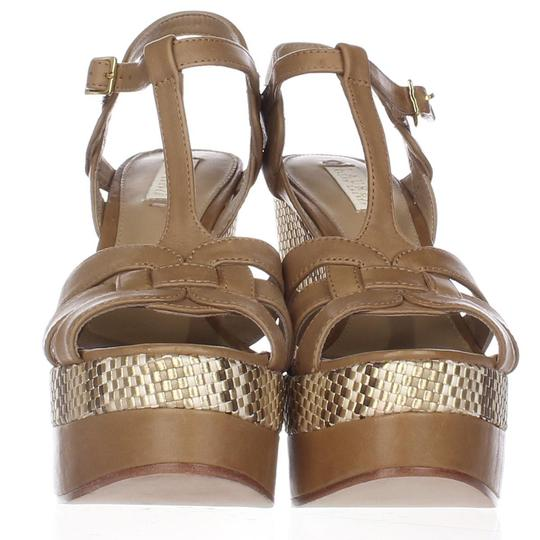 Preload https://img-static.tradesy.com/item/24220097/lauren-ralph-lauren-brown-maeva-t-strap-wedge-sandals-950-toast-40e-platforms-size-us-9-regular-m-b-0-0-540-540.jpg