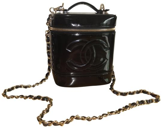 Preload https://img-static.tradesy.com/item/24220272/chanel-vanity-case-vintage-timeless-black-patent-leather-cross-body-bag-0-1-540-540.jpg