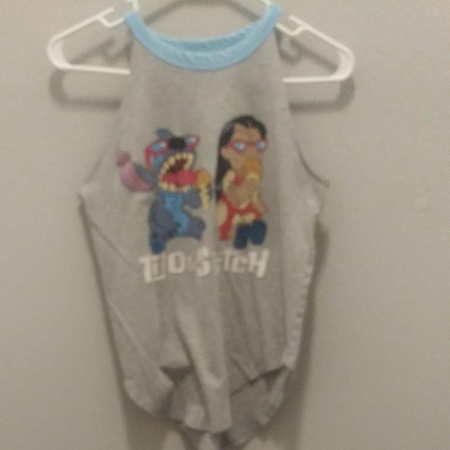 Disney Top Flowy on bottom fits like a bigger small 3-5 adult
