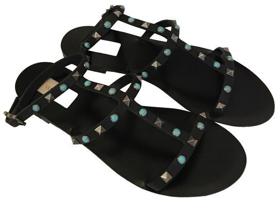 Preload https://img-static.tradesy.com/item/24222152/valentino-black-rock-studded-gladiator-sandals-size-eu-39-approx-us-9-regular-m-b-0-1-540-540.jpg